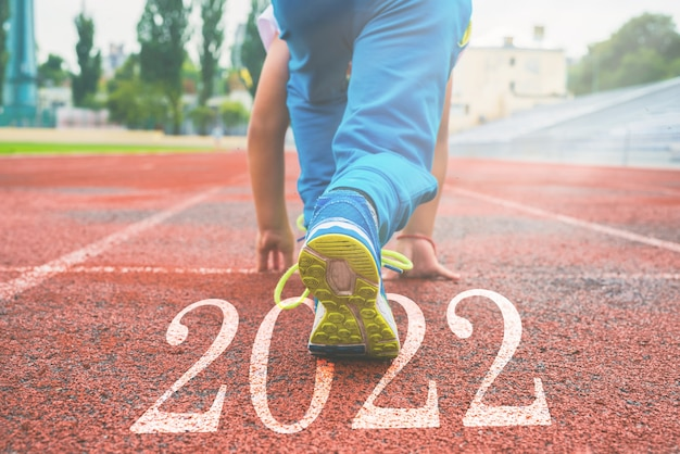 Close-up of legs in sneakers at the start. beginning and beginning of the new 2022, goals and plans for the next year