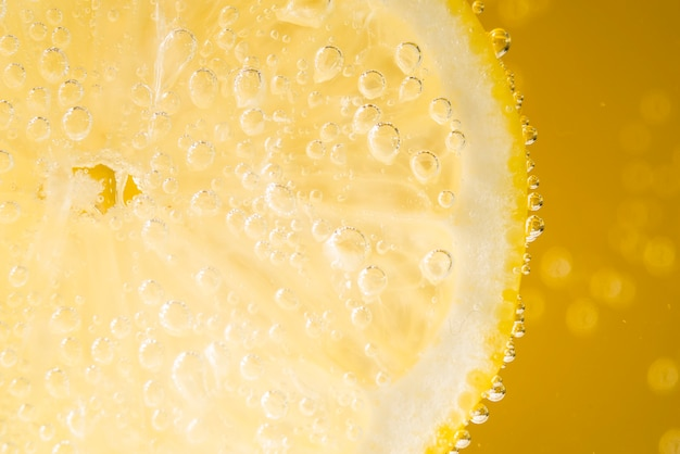 Close-up lemon slice with water drops