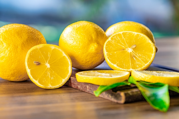 Close up of lemons on wooden surface