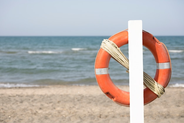 Close up lifebuoy on beach