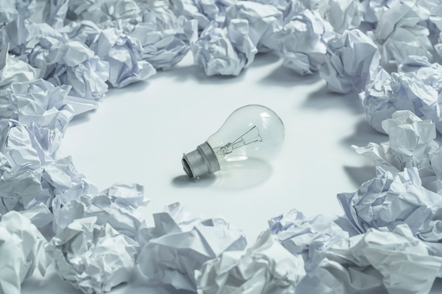 Close up on lightbulb and paper crumpled