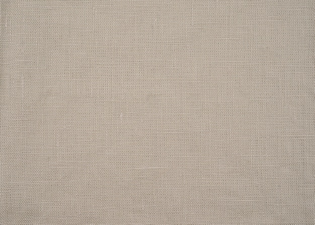 Close-up linen texture of natural beige organic fabric or cloth