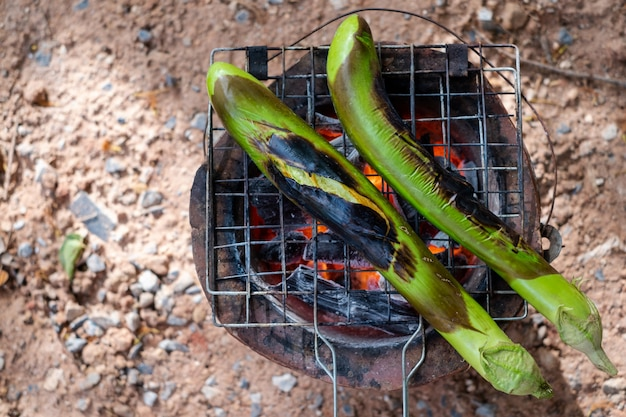 Close-up long green eggplants barbecue grilled on hot charcoal. concept health. folk life.