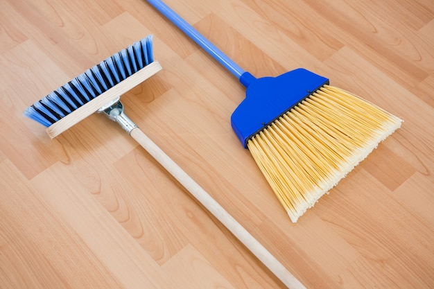 Close up of long handle brooms