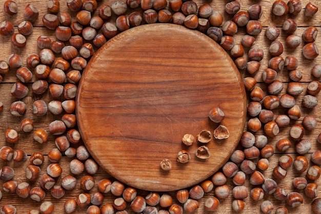 Close-up of a lot of hazelnuts on vintage wooden background.