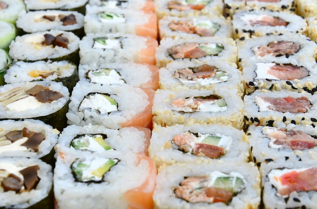 Close-up of a lot of sushi rolls with different fillings