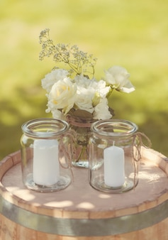 Close up of lovely candles in jars