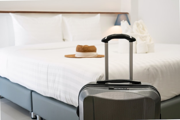 Close up of luggage in hotel room. holiday, vacation concept.