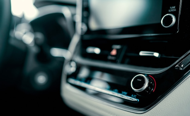 Close up luxury car interior. steering wheel, shift lever and dashboard.