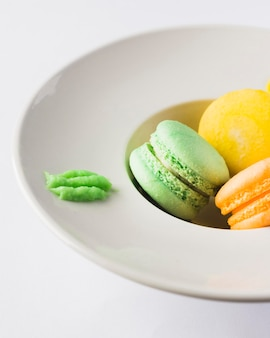 Close-up macarons in deep plate