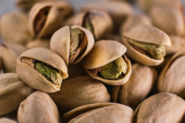 Close-up macro of green open pistachio nuts. selective focus