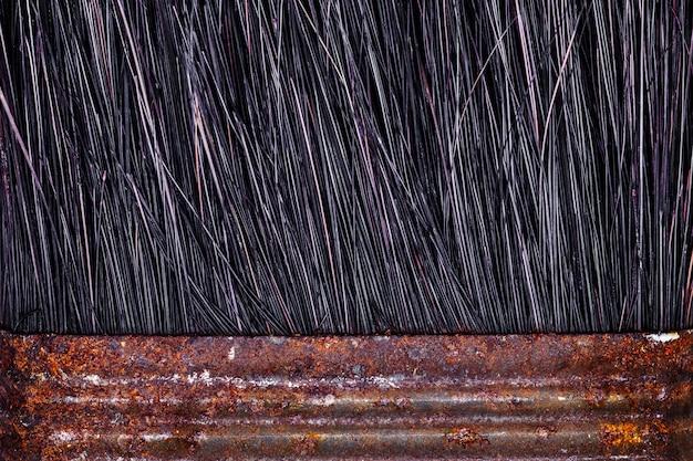 Close up macro shot of rusty paint brushes.
