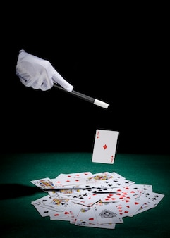 Close-up of magician's hand performing trick on playing cards