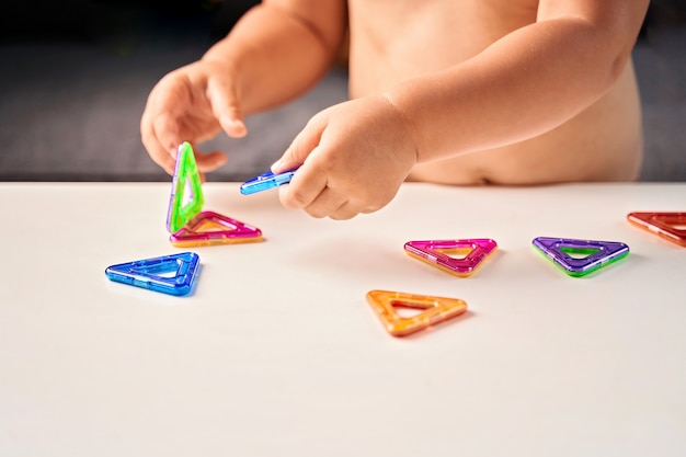 Close up of magnetic building toy. child playing with development toy. high quality photo