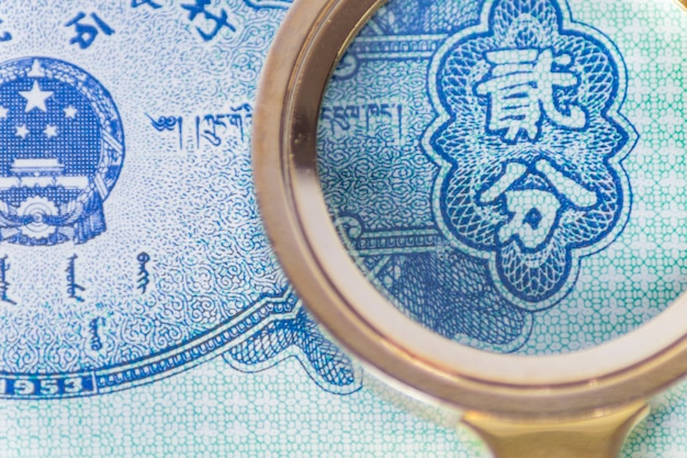 Close-up of magnifying glass on a banknote