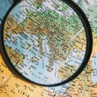 Close-up magnifying glass over globe