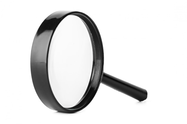 Close up of magnifying glass isolated on white