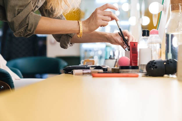 Close up of a makeup artist preparing her instruments for a new customer in the beauty salon