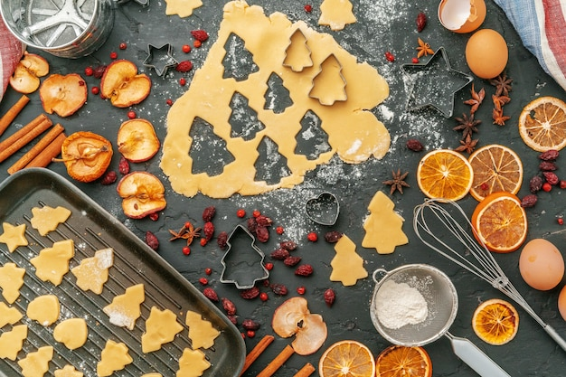 Close up of making holiday christmas gingerbread cookies process