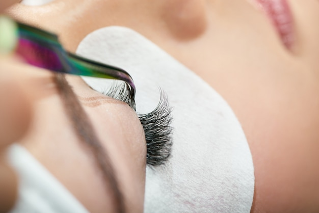 Close up of making lashes with tweezers