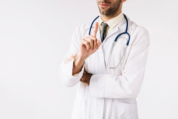 Close-up of a male doctor pointing index finger