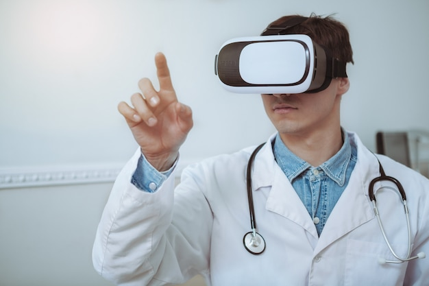 Close up of a male doctor wearing 3d vr glasses