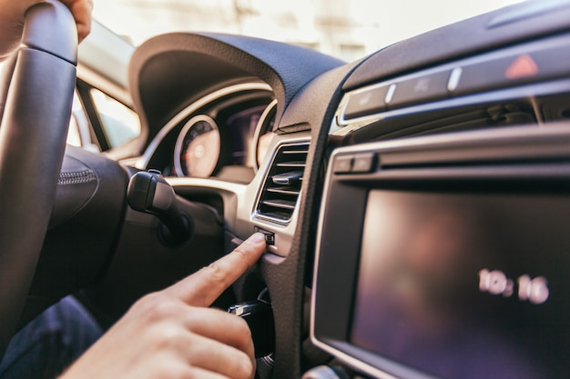 Close-up of a male hand  in a modern car