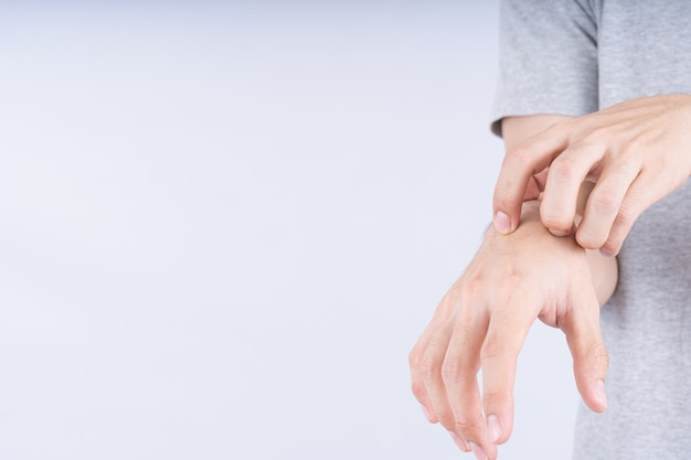 Close up on male hand scratching on his hand