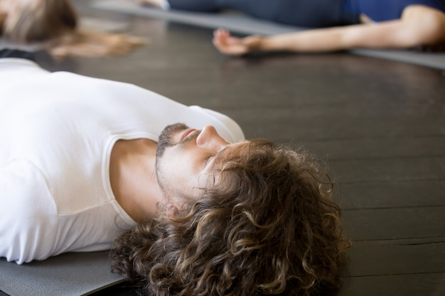 Close up of male head, savasana pose