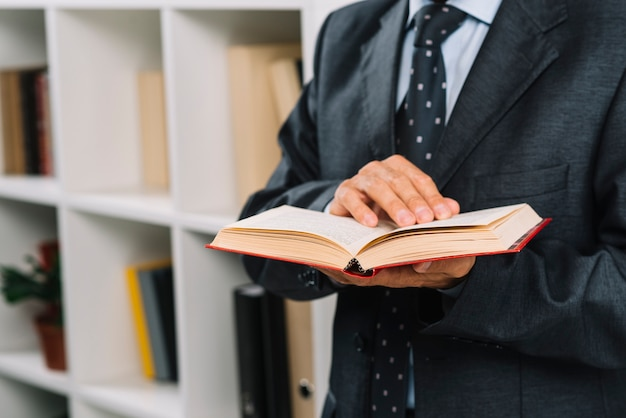 Close-up of male lawyer holding law book