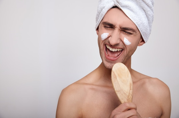 A close-up of a man after a shower and a spa sings.