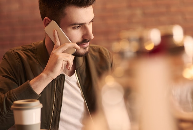 Close up of man calling in cafe bar