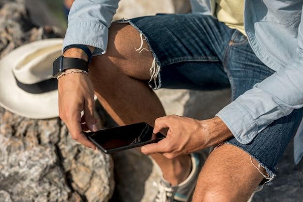 Close up man checking his phone