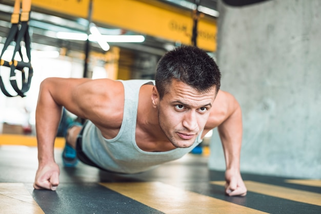 Close-up of a man doing workout in gym