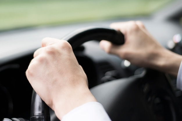 Close-up of man driving a car