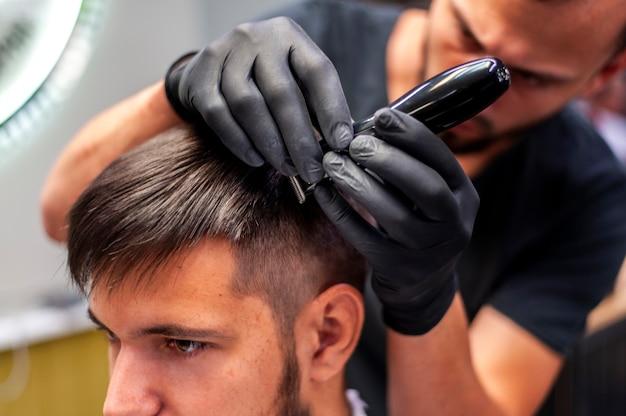 Close-up man getting a haircut