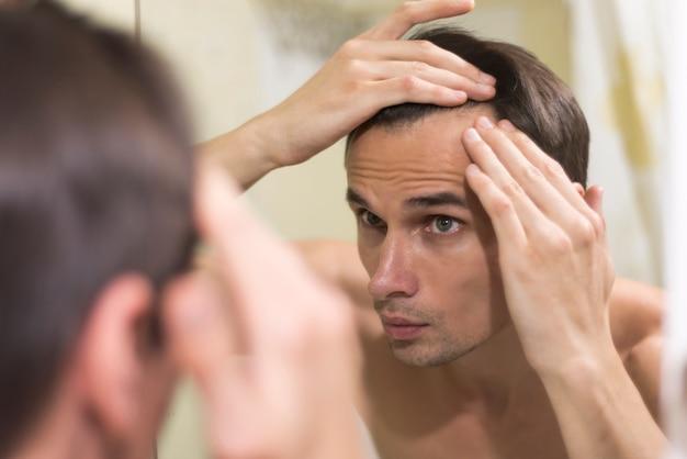 Close up man grooming hair