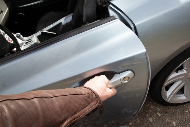 Close up of a man hand opening car door
