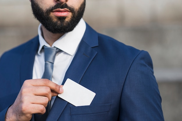 Close-up man holding business card