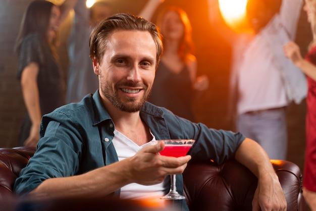 Close up man holding drink