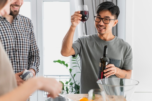 Close up man holding glass of wine