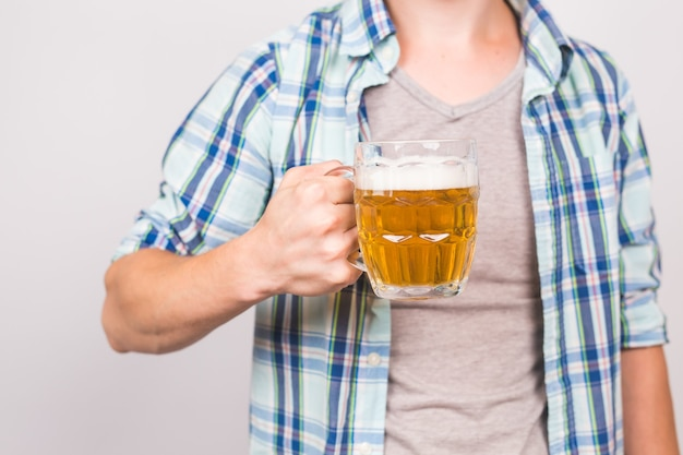 Close up of man holding a mug of beer. background with copy space.