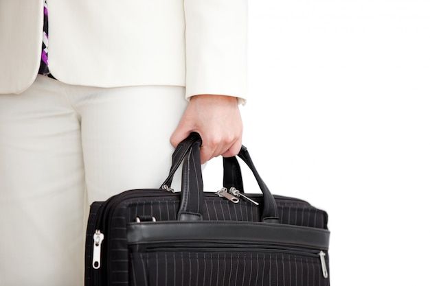 Close up of a man holding a suitcase