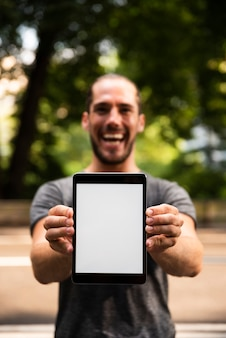 Close-up of man holding tablet mock-up