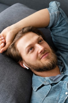Close up man laying on couch