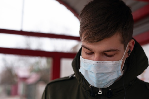 Close-up of a man in a medical mask, quarantine in russia, ukraine. viral infection covid-19.coronavirus pandemic epidemic.
