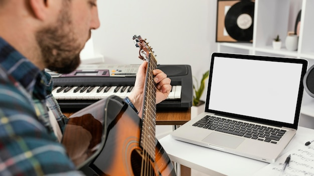 Close-up man playing the guitar