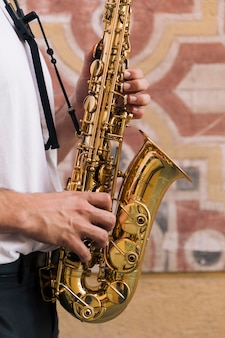 Close up man playing the saxophone