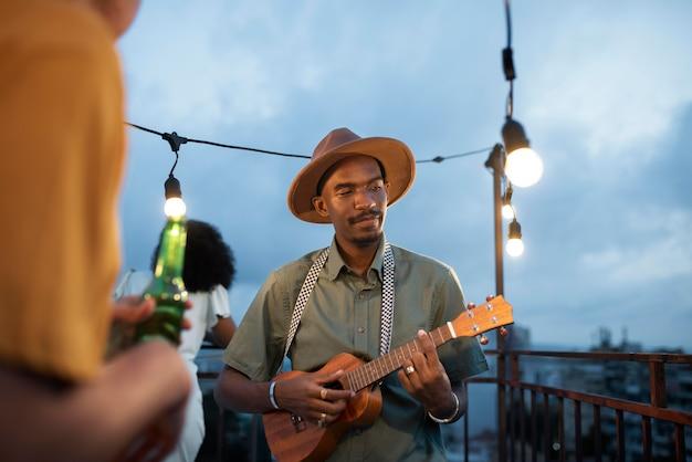Close up man playing the ukulele