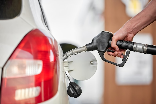 Close-up of a man pumping diesel in to the tank